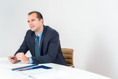 Business man executive holding pen, wearing tuxedo and tie. Confident Senior Business leader stock images