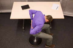 Business man exercising at  desk at workplace Royalty Free Stock Photos