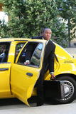 Business Man Exiting Taxi Stock Photo