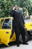 Business Man Exiting Taxi Royalty Free Stock Photos