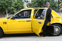 Business Man Exiting Taxi Stock Image