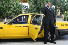 Business Man Exiting Taxi Stock Photography
