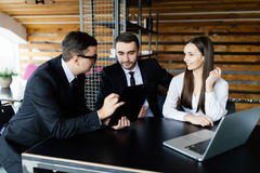Business man explain his team all details of documents at office desk. Royalty Free Stock Photography