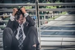 Business man failed to feeling hopeless, distraught, sad and dis. Couraged in life. Concept failing businesses stock image