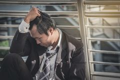 Business man failed to feeling hopeless, distraught, sad and dis. Couraged in life. Concept failing businesses royalty free stock photo