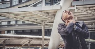 Business man failed to feeling hopeless, distraught, sad and dis. Couraged in life. He tried to use his own neck to kill himself.Concept failing businesses stock photo