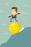 Business man falling on a dollar coin Royalty Free Stock Photography
