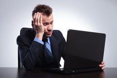 Business man falls asleep at laptop Stock Photo