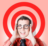 Business man in fear on target background Royalty Free Stock Photography
