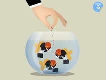 Business man feeding goldfish that dress business suit Royalty Free Stock Photo