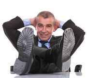 Business man with feet on desk smiles at you Royalty Free Stock Photo