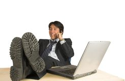 Business man with feet up on the phone Royalty Free Stock Photo