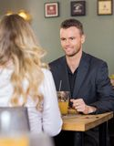Business man With Female Colleague At Coffeeshop Stock Photo