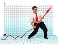 Business man fighting graph arrow Stock Photos