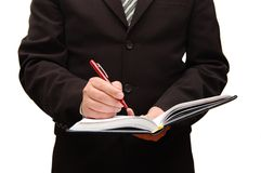 Business man filling out paperwork Stock Images