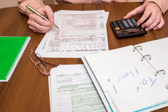 Business man filling out  1040 tax form Stock Photography
