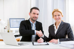 Business man finalising agreement at the office Royalty Free Stock Photos