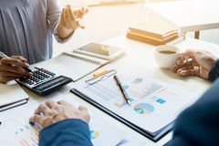 Business man financial inspector and secretary making report, ca. Lculating or checking balance. Internal Revenue Service inspector checking document. Audit Royalty Free Stock Photos