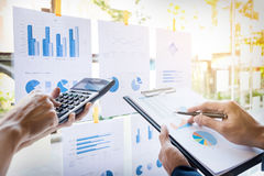 Business man financial inspector and secretary making report, ca. Lculating or checking balance. Internal Revenue Service inspector checking document. Audit Royalty Free Stock Image