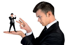 Business man finger flipping on little man Royalty Free Stock Photos
