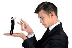 Business man finger flipping on little man Stock Image