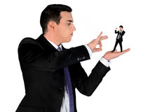 Business man finger flipping on little man Stock Photography