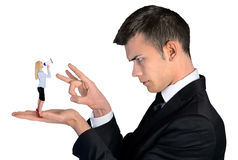 Business man finger flipping on little woman Stock Images