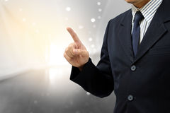 Business man finger point up on abstract background stock image