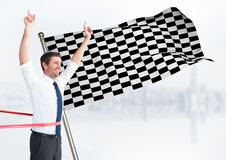 Business man at finish line against white skyline and checkered flag. Digital composite of Business man at finish line against white skyline and checkered flag Royalty Free Stock Image