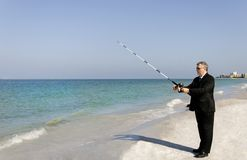 Business Man Fishing Royalty Free Stock Photos