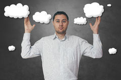 Business man with fixed eyes in the clouds. Ideas that come outside the box Royalty Free Stock Photography