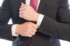 Business man fixing his arm sleeve Stock Photography