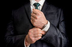 Business man fixing his cufflinks Stock Images