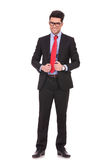 Business man fixing his suit jacket Royalty Free Stock Image