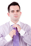 Business man fixing his tie Royalty Free Stock Images