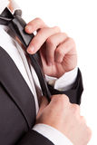 Business man fixing his tie Stock Image