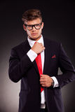 Business man fixing his tie Stock Images
