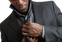 Business man fixing his tie Stock Photos