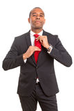 Business man fixing his tie Royalty Free Stock Photography