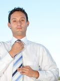 Business man fixing tie Stock Photo