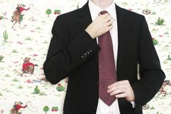 Business man fixing tie Stock Photography