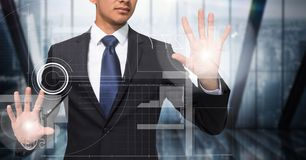 Business man with flares on hands touching white interface against dark blurry window. Digital composite of Business man with flares on hands touching white Stock Photo