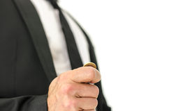 Business man flipping a coin Royalty Free Stock Images