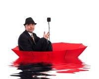 Business man floating on umbrella Stock Image