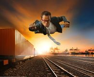 Business man flying against logistic industry background stock images