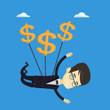 Business man flying with dollar signs. Royalty Free Stock Photography