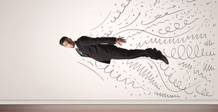 Business man flying with hand drawn lines comming out Stock Images