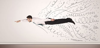Business man flying with hand drawn lines comming out Stock Photo