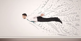 Business man flying with hand drawn lines comming out Royalty Free Stock Image