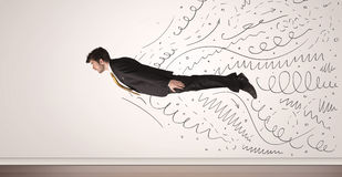 Business man flying with hand drawn lines comming out Stock Photos